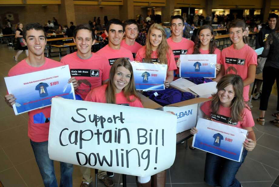 Klein Oak High School student council members, including Kara Rozell, front, left, and Emily Frost, president, front right, and Brad Dohner, vice-president, back, left, David Hodgins, Chris Toth, Noah Scanlon, Allie McManus, Alex Content, Kelli Lahasky and Connor Ivy, are fundraising for homecoming by selling t-shirts in support of wounded firefighter captain Bill Dowling.   Klein Oak High School student council members, including Kara Rozell, front, left, and Emily Frost, president, front right, and Brad Dohner, vice-president, back, left, David Hodgins, Chris Toth, Noah Scanlon, Allie McManus, Alex Content, Kelli Lahasky and Connor Ivy, are fundraising for homecoming by selling t-shirts in support of wounded firefighter captain Bill Dowling. Photo: Jerry Baker, Freelance