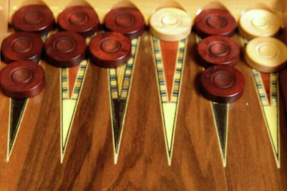 One of Bill Riles' favorite backgammon boards was made by Tak Morioka.
