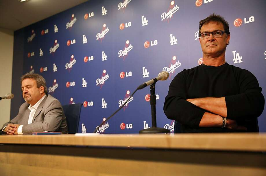 Los Angeles Dodgers general manager Ned Colletti, left, and Dodgers manager Don Mattingly, right, speak to the media at Dodger Stadium in Los Angeles, California, on Monday, October 21, 2013. (Al Seib/Los Angeles Times/MCT) Photo: Al Seib, McClatchy-Tribune News Service