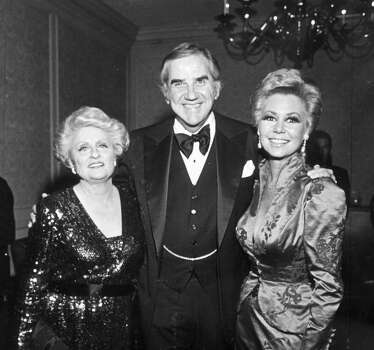 "HOUCHRON CAPTION (02/18/1979):  Maxine and pals --  Chronicle columnist Maxine Mesinger, left, is greeted by friends Ed McMahon and Mitzi Gaynor, who were among her Hollywood friends and local personalities who 'roasted' her Saturday at the Galleria Plaza Hotel Ballroom. The event, which followed a dinner and auction of celebrity items, benefitted the Easter Seal Society of Harris County.   HOUCHRON CAPTION (01/20/2001):  Miss Moonlight's memories: Maxine Mesinger's coverage of the rich and famous made her an icon, but she never lost her passion for a scoop.   In a testament to her largess, the inimitable Mesinger was ""roasted"" by Hollywood friends Ed McMahon and Mitzi Gaynor in 1979 at a charity event at the Galleria Plaza Hotel Ballroom.  HOUCHRON CAPTION (09/04/2001):  Gaynor. Photo: BUSTER DEAN, STAFF / HOUSTON CHRONICLE"