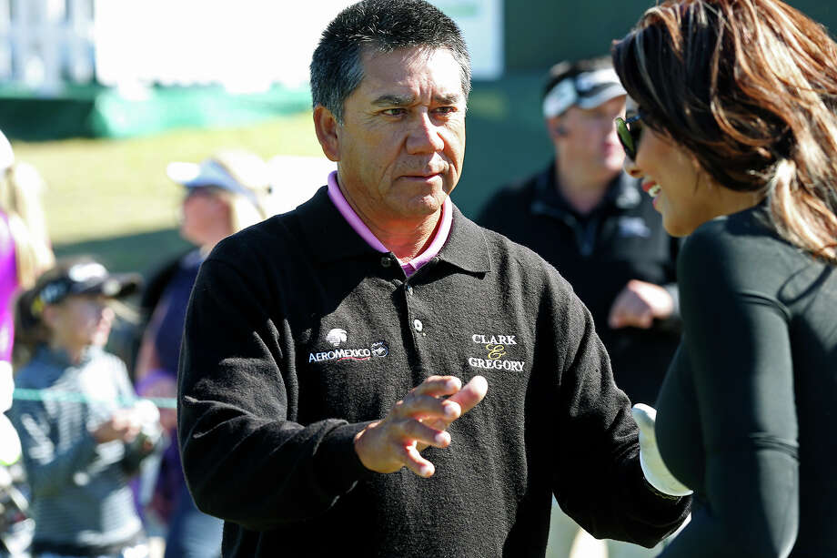 Mexican professional golfer Esteban Toledo coaches radio personality Claudia Hill before the Battle of the Network Stars at TPC San Antonio, Tuesday, Oct. 22, 2013. The AT&T Championship Tournament will start on Friday and run through Sunday. Photo: Jerry Lara, San Antonio Express-News / ©2013 San Antonio Express-News