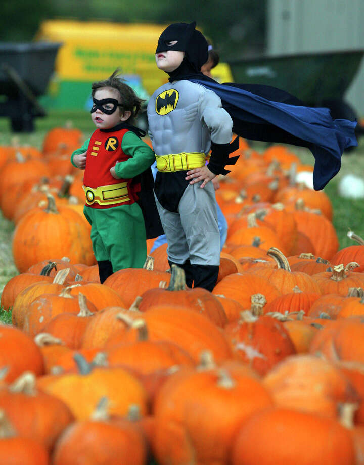 Two-year-old Westin Smith, a.k.a the Boy Wonder, and Shepherd Smith as Batman, aged 5, pose at Alamo Heights United Methodist Church's pumpkin patch, 825 E. Basse Road.