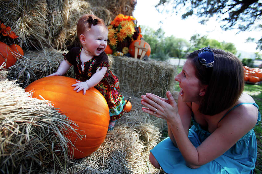 Janice Derington of Schertz, right, helps her daughter, 6-month-old Hannah Derington, pose for a picture on the first day of the pumpkin patch at Bracken United Methodist Church, 20377 FM 2252. The patch is open daily from 9 a.m. to dusk through Oct. 31. Contact 830-606-6717, or brackenumc@satx.rr.com. Visit the site.