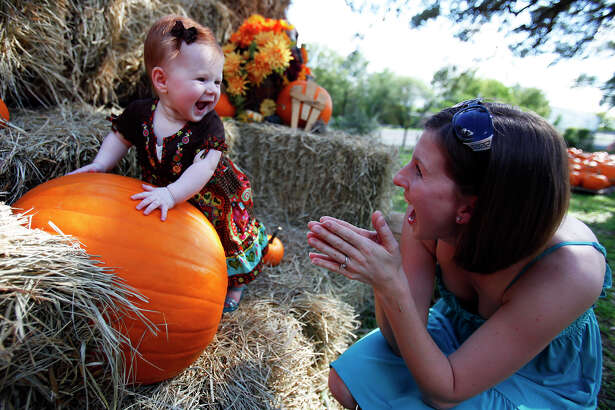 Janice Derington of Schertz, right, helps her daughter, 6-month-old Hannah Derington, pose for a picture on the first day of the pumpkin patch at Bracken United Methodist Church, at 20377 FM 2252. The patch is open daily from 9 a.m. to dusk though Oct. 31. Prices for pumpkins and gourds start at .50 cents. On weekends the patch features hayrides and rides on the Pumpkin Patch Express train. Contact 830-606-6717, or brackenumc@satx.rr.com. Visit the site.