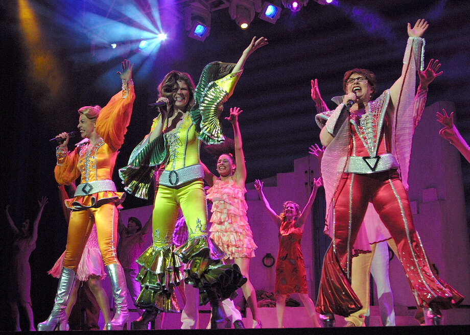 Ellen Harvey (from left), Monique Lund, Robin Baxter, the music of ABBA and a lively cast gets everybody on their feet in the production of Mamma Mia! at the Majestic Theater in 2003. Photo: J. MICHAEL SHORT, San Antonio Express-News / SAN ANTONIO EXPRESS-NEWS