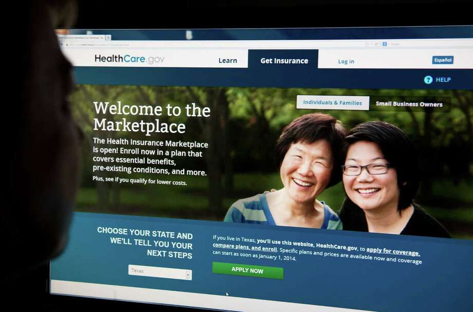 Premiums for plans on the government health insurance exchange are mostly going down in Houston. Photo: KAREN BLEIER, Staff / AFP ImageForum