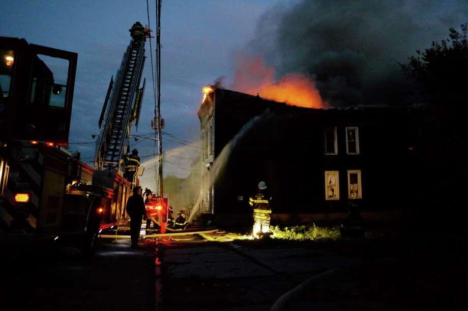 Firefighters battle a house fire at 232 1st Street on Tuesday, Oct. 22, 2013 in Albany, NY.   (Paul Buckowski / Times Union) Photo: Paul Buckowski / 00024367A