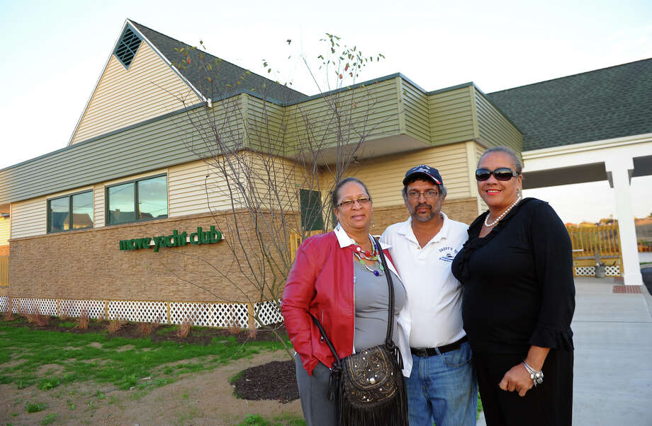 M.O.V.E. Yacht Club Commodore Pedro Soto poses with female members Jacqueline Richardson, left, and Evette Brantley, right, in front of the club's new location on Waterview Avenue in Bridgeport, Conn. on Tuesday October 22, 2013. The yacht club moved from its old location because of the Steel Point development project, which is now underway. Photo: Christian Abraham / Connecticut Post