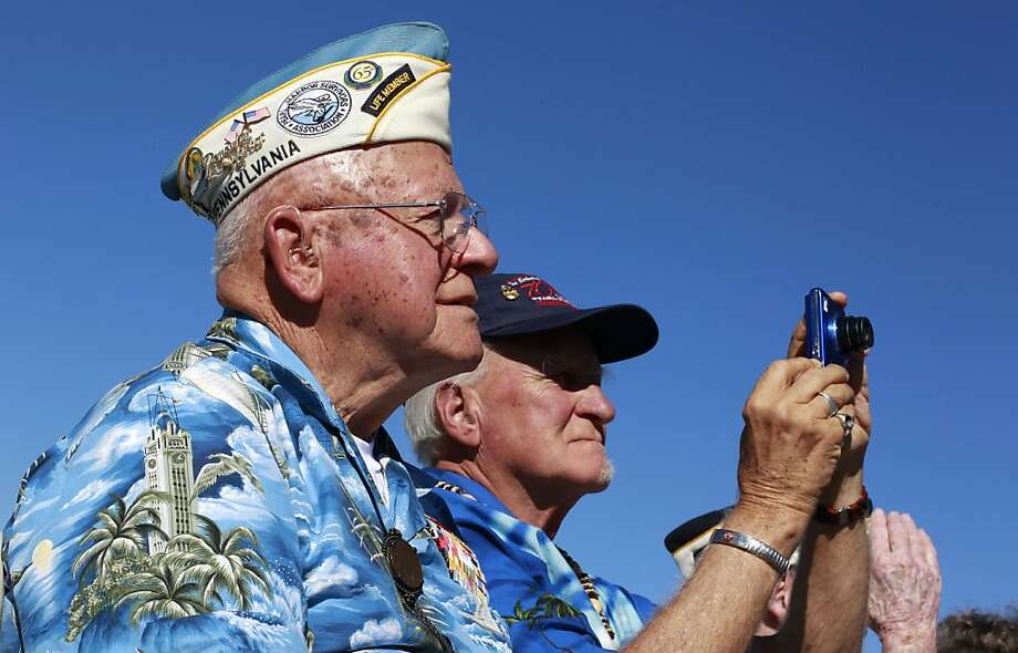 Pearl Harbor survivor, Mickey Ganitch, (left) of San Leandro and John Antczak, honorary member of the Pearl Harbor Survivors association observe the installation of the beacon atop the summit building at Mt. Diablo, Calif. on Tuesday Oct. 22, 2012. Photo: Michael Macor, The Chronicle
