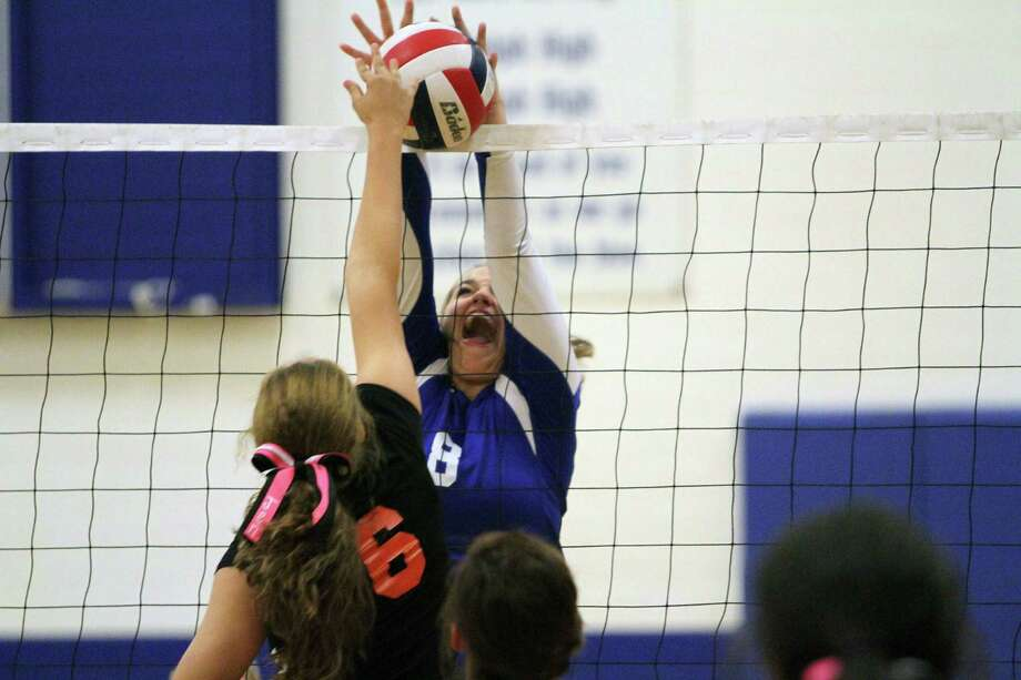 Lady Ro-Hawk Bailey McNally (8) goes up for the block Friday during Randolph's 3-0 match win over Brooks Academy. Photo: Greg Bell / For The NE Herald