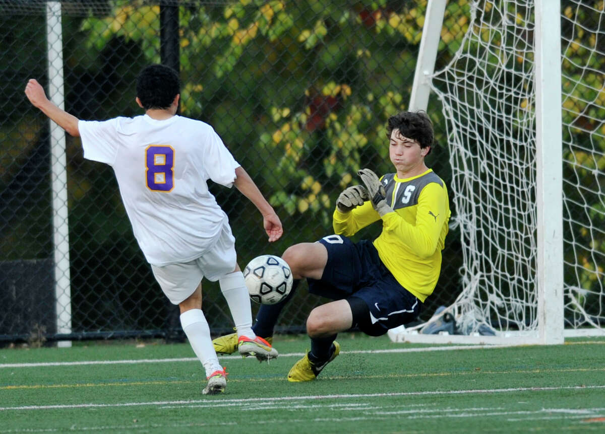 Staples' goalie Brenden Price denies the shot on goal from Westhill's Denny Lopez in their game at Westhill High School in Stamford, Conn., on Tuesday, Oct. 22, 2013. Westhill won, 2-0.