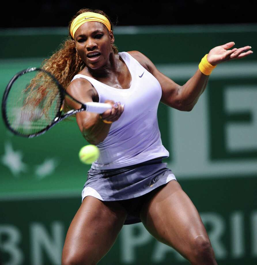 Serena Williams of the United States returns the ball to Angelique Kerber of Germany on October 22, 2013 during a WTA Championships match in Istanbul. AFP PHOTO / BULENT KILICBULENT KILIC/AFP/Getty Images Photo: BULENT KILIC / AFP