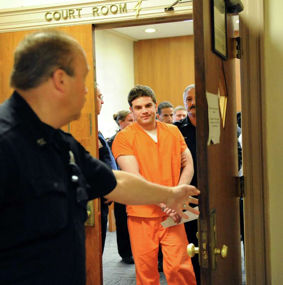 Brice Rivenburgh leaves the courtroom after being sentenced 45 years to life for the double murder of his ex-girlfriend Jessica McCormack and her mother Tammy McCormack on Tuesday, Oct. 22, 2013, at the Schenectady County Courthouse in Schenectady, N.Y. (Cindy Schultz / Times Union) Photo: Cindy Schultz / 00024328A