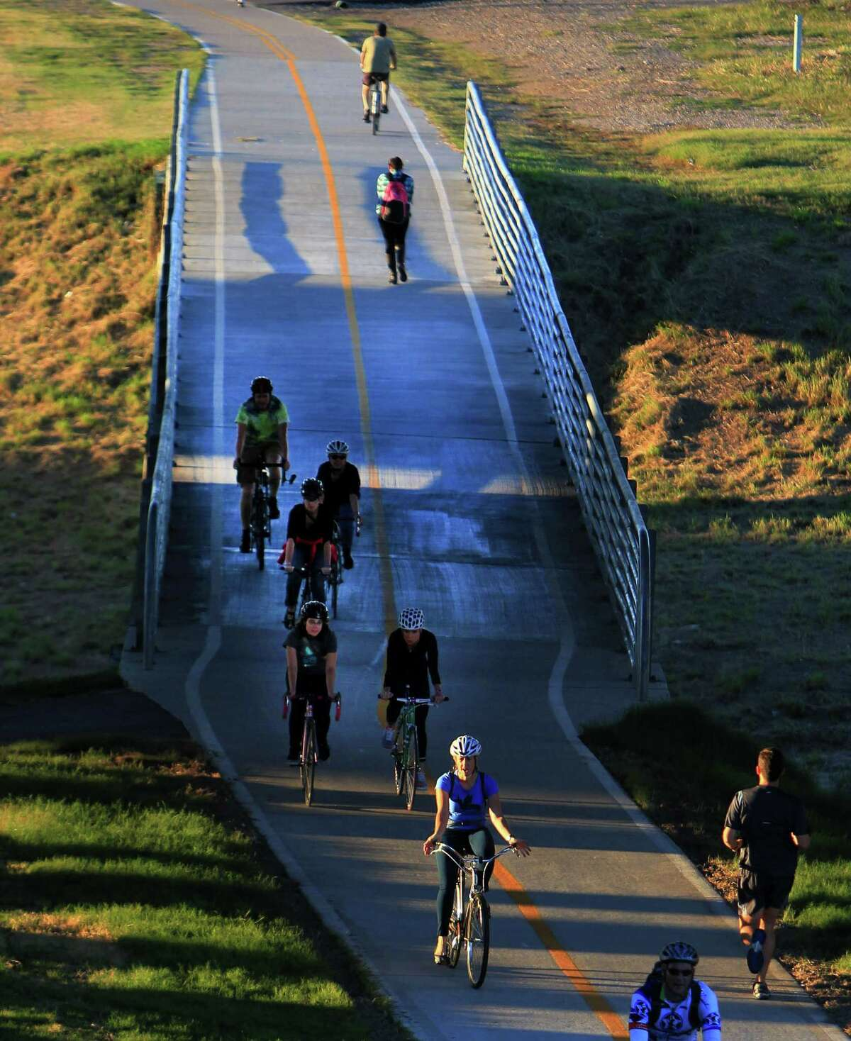 Tuesday's crisp, sunny weather lured cyclists and joggers onto the Heights Bike Trail ride over White Oak Bayou and under Interstate 10 near downtown.