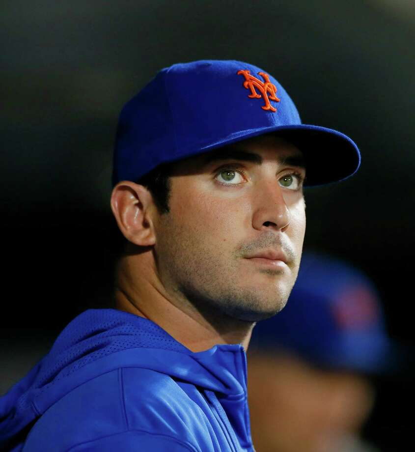 FILE - In this Aug. 26, 2013, file photo, New York Mets pitcher Matt Harvey stands in the Mets dugout watching the baseball game in the seventh inning against the Philadelphia Phillies at Citi Field in New York. Harvey has had elbow-reconstruction surgery, and he will miss the entire 2014 season. Dr. James Andrews performed the operation that repaired a partial tear of the ulnar collateral ligament in Harvey's right elbow on Tuesday, Oct. 22, 2013. Recovery from Tommy John surgery typically takes about a year.  (AP Photo/Paul J. Bereswill, File) ORG XMIT: NY175 Photo: Paul Bereswell / FR168017 AP