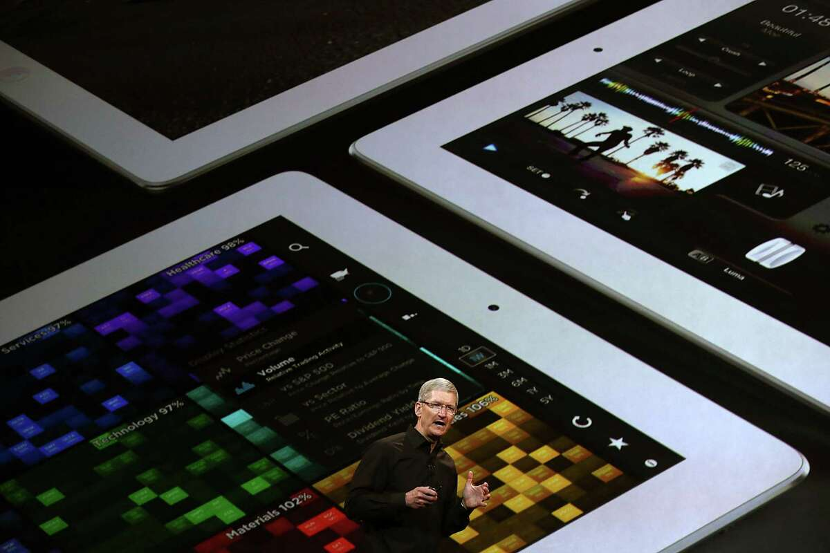Apple CEO Tim Cook introduces new Apple products Tuesday in San Francisco. The name of the company's next-generation tablet computer is the iPad Air, which weighs only a pound.