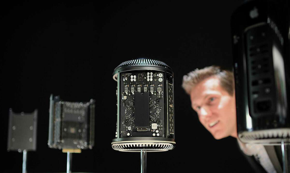 A Mac Pro computer and its components are displayed Tuesday during an Apple event. The device comes with a case that's 9.9 inches tall.