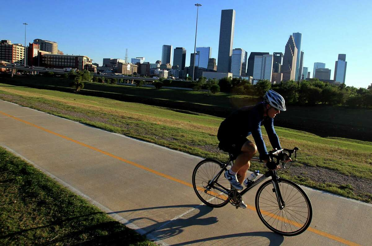 Biking A report card issued by the League of American Bicyclists saw Texas take a tumble in its ranking of bike-friendly states. Seen above: A cyclist uses the Heights Bike Trail along the Buffalo Bayou in Houston.