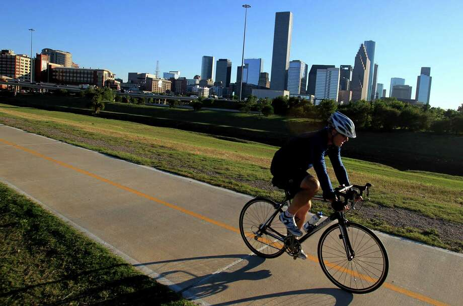 Cyclist use the Heights Bike Trail along the Buffalo Bayou on Tuesday, Oct. 22, 2013, in Houston.  Rich and Nancy Kinder announce plans to donate $50 Million to Houston Parks Board for Bayou Greenways 2020 project. Photo: Mayra Beltran, Houston Chronicle / © 2013 Houston Chronicle