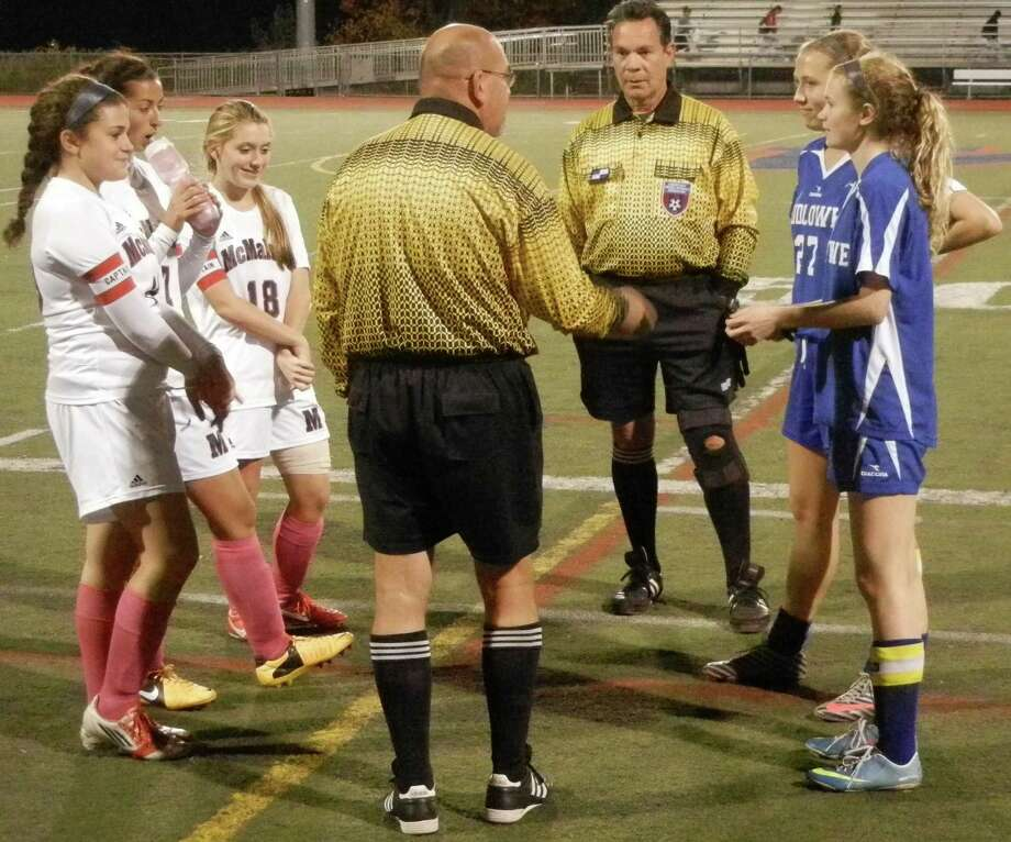Captains meet before the start of the FCIAC girls soccer match on Tuesday, Oct. 22 between visiting Fairfield Ludlowe, in blue, and host Brien McMahon, in white and pink. Ludlowe won 2-1. Photo: Reid L. Walmark / Fairfield Citizen