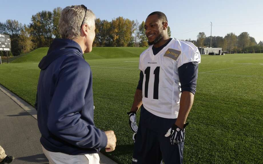 Seattle Seahawks wide receiver Percy Harvin (11) talks with head coach Pete Carroll, left, after NFL football practice, Tuesday, Oct. 22, 2013, in Renton, Wash. It was Harvin's first full team practice since he injured his hip during the off-season. Photo: Ted S. Warren, Associated Press
