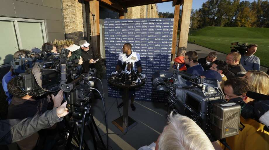 Seattle Seahawks wide receiver Percy Harvin, center, talks to reporters after NFL football practice, Tuesday, Oct. 22, 2013, in Renton, Wash. It was Harvin's first full team practice since he injured his hip during the off-season. Photo: Ted S. Warren, Associated Press