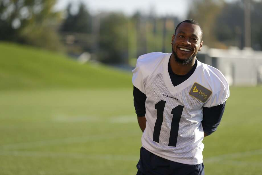 Seattle Seahawks wide receiver Percy Harvin (11) smiles as he waits to talk to reporters after NFL football practice, Tuesday, Oct. 22, 2013, in Renton, Wash. It was Harvin's first full team practice since he injured his hip during the off-season. Photo: Ted S. Warren, Associated Press