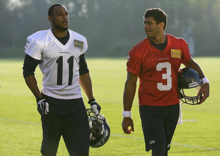 Seattle Seahawks wide receiver Percy Harvin (11) walks with quarterback Russell Wilson at the end of NFL football practice, Tuesday, Oct. 22, 2013, in Renton, Wash. It was Harvin's first full team practice since he injured his hip during the off-season. Photo: Ted S. Warren, Associated Press