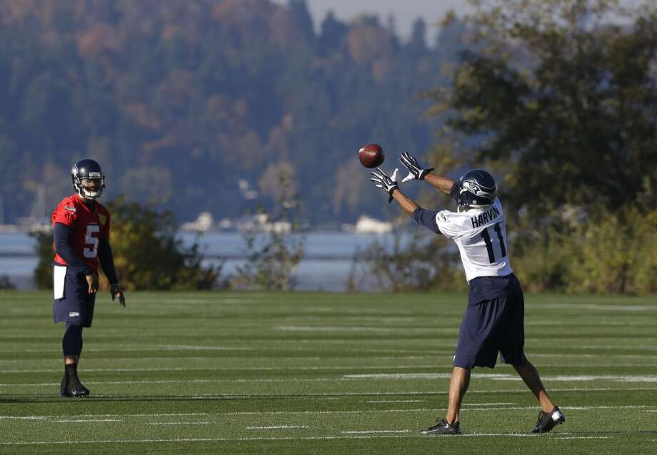 Seattle Seahawks wide receiver Percy Harvin (11) catches a pass from backup quarterback B.J. Daniels during NFL football practice, Tuesday, Oct. 22, 2013, in Renton, Wash. It was Harvin's first full team practice since he injured his hip during the off-season. Photo: Ted S. Warren, Associated Press