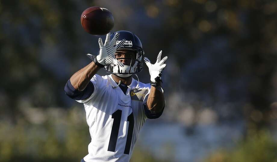Seattle Seahawks wide receiver Percy Harvin makes a catch as he takes part in NFL football practice, Tuesday, Oct. 22, 2013, in Renton, Wash. It was Harvin's first full team practice since he injured his hip during the off-season. Photo: Ted S. Warren, Associated Press