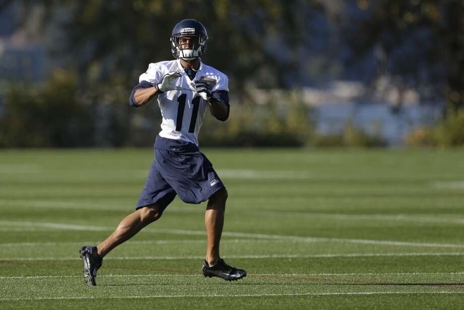 Seattle Seahawks wide receiver Percy Harvin looks for a pass as he takes part in an NFL football practice, Tuesday, Oct. 22, 2013, in Renton, Wash. It was Harvin's first full team practice since he injured his hip during the off-season. Photo: Ted S. Warren, Associated Press