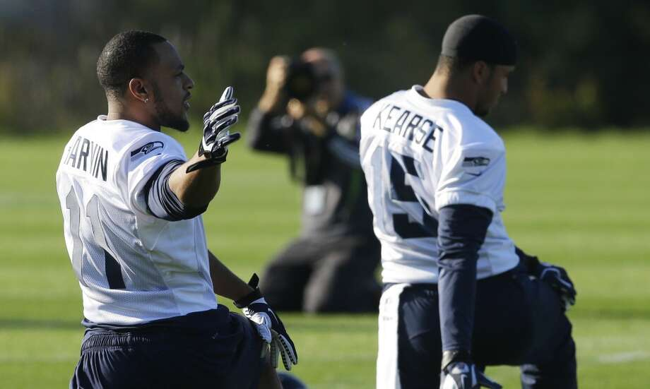 Seattle Seahawks wide receiver Percy Harvin, left, stretches next to wide receiver Jermaine Kearse, right, at the start of an NFL football practice, Tuesday, Oct. 22, 2013, in Renton, Wash. It was Harvin's first full team practice since he injured his hip during the off-season. Photo: Ted S. Warren, Associated Press