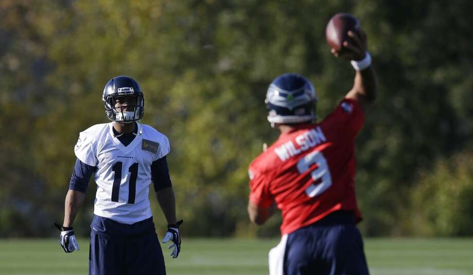 Seattle Seahawks wide receiver Percy Harvin (11) catches a pass from Seahawks quarterback Russell Wilson (3) as they take part in an NFL football practice, Tuesday, Oct. 22, 2013, in Renton, Wash. It was Harvin's first full team practice since he injured his hip during the off-season. Photo: Ted S. Warren, Associated Press