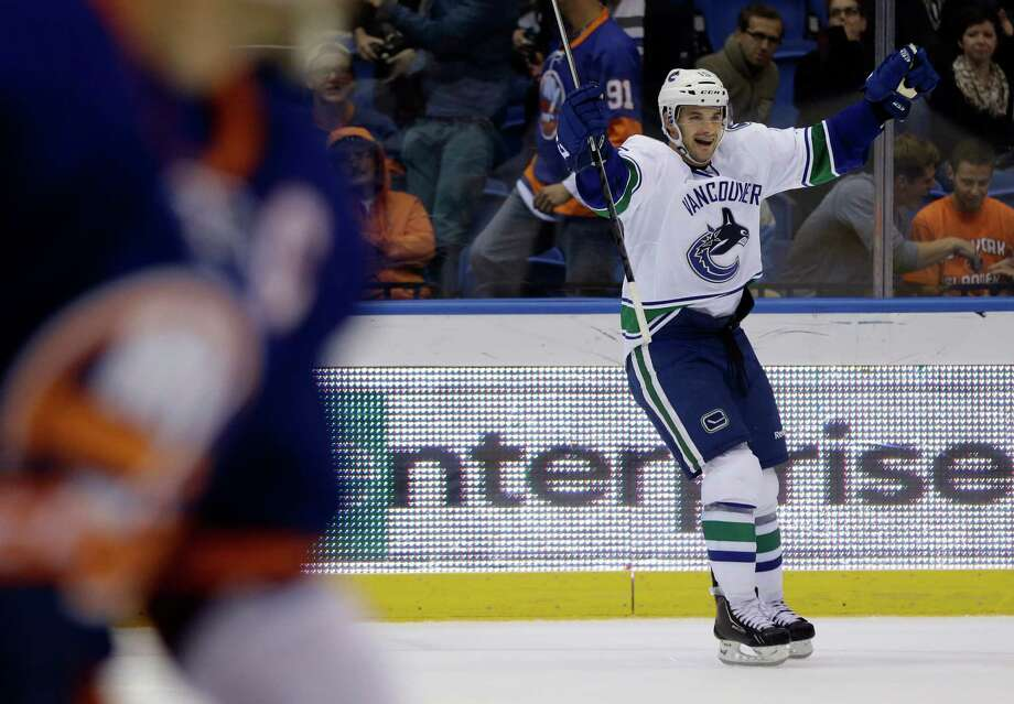 Vancouver Canucks' Brad Richardson (15) celebrates after scoring during the overtime period of an NHL hockey game Tuesday, Oct. 22, 2013 in Uniondale, N.Y. The Canucks won the game 5-4. (AP Photo/Frank Franklin II) ORG XMIT: NYI118 Photo: Frank Franklin II / AP
