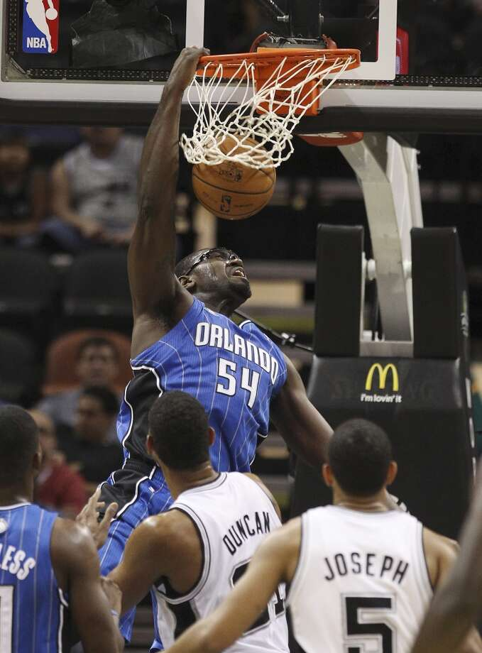 Orlando Magic's Jason Maxiell dunks over Spurs' Tim Duncan during their preseason game at the AT&T Center on Tuesday, Oct. 22, 2013. Photo: Kin Man Hui, San Antonio Express-News