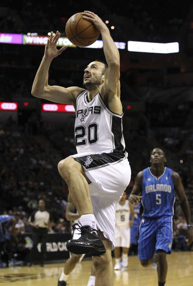 Spurs' Manu Ginobili drives to the basket against the Orlando Magic during their preseason game at the AT&T Center on Tuesday, Oct. 22, 2013. Photo: Kin Man Hui, San Antonio Express-News