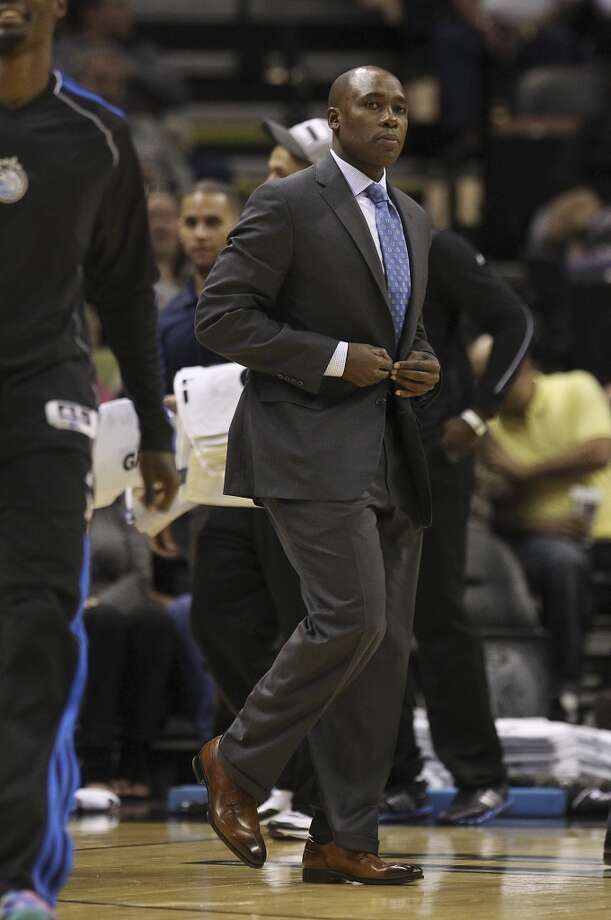 Orlando Magic head coach Jacque Vaughn heads out to talk with his team during a timeout in their preseason game against the Spurs at the AT&T Center on Tuesday, Oct. 22, 2013. Photo: Kin Man Hui, San Antonio Express-News