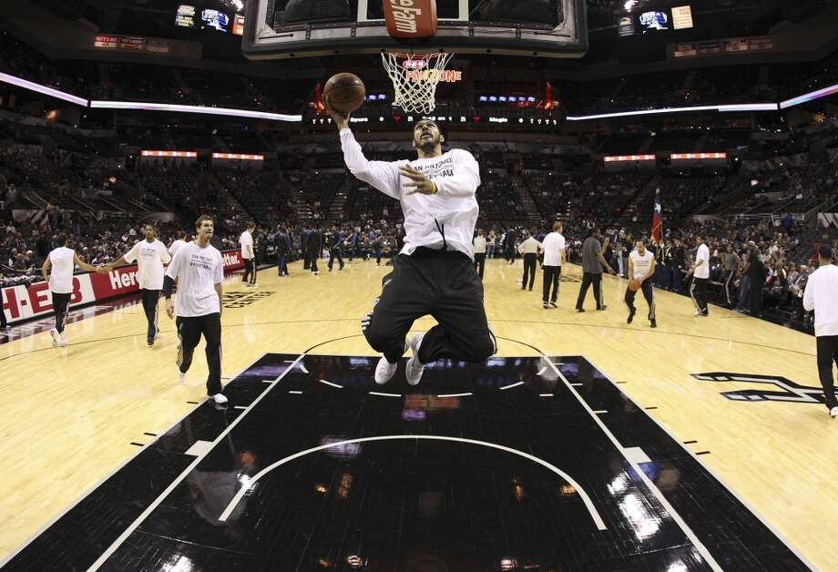 Spurs' Jeff Ayres goes up for a shot during warm up before the game against the Orlando Magic at the AT&T Center on Tuesday, Oct. 22, 2013. Photo: Kin Man Hui, San Antonio Express-News