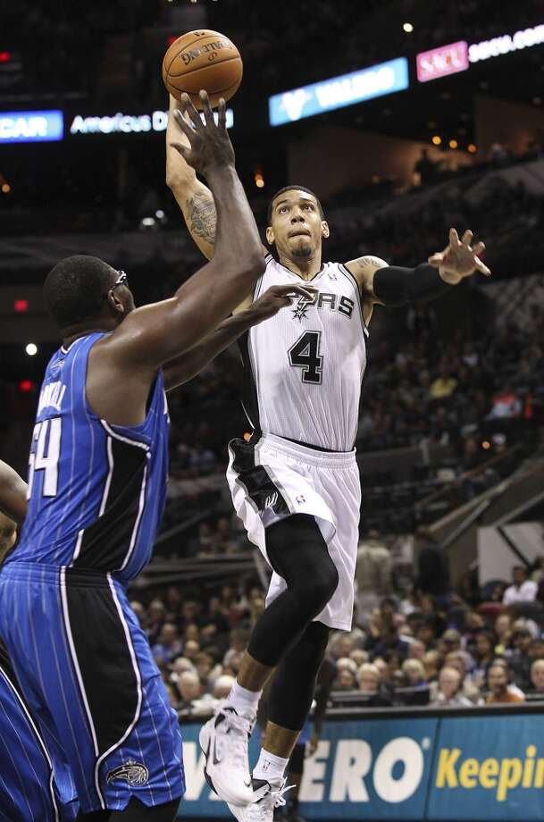 Spurs' Danny Green attempts a dunk against the Orlando Magic's Jason Maxiell during their preseason game at the AT&T Center on Tuesday, Oct. 22, 2013. Spurs prevailed 123-101. Photo: Kin Man Hui, San Antonio Express-News