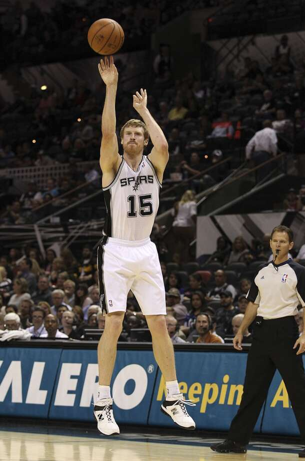 Spurs' Matt Bonner attempts a shot against the Orlando Magic during their preseason game at the AT&T Center on Tuesday, Oct. 22, 2013. Spurs prevailed 123-101. Photo: Kin Man Hui, San Antonio Express-News