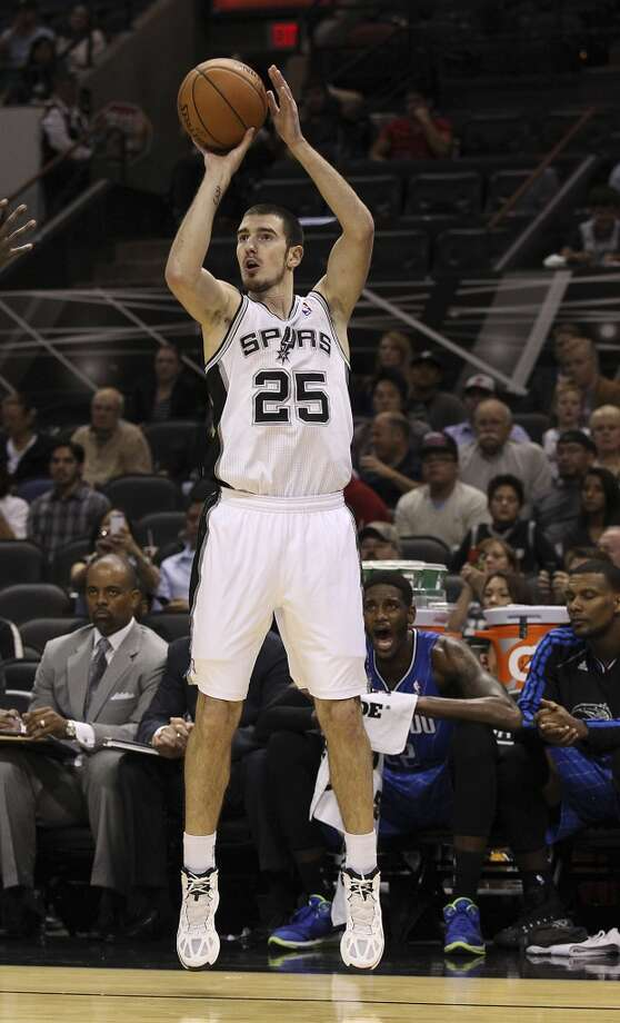 Spurs' Nando De Colo takes a shot against the Orlando Magic during their preseason game at the AT&T Center on Tuesday, Oct. 22, 2013. Spurs prevailed 123-101. Photo: Kin Man Hui, San Antonio Express-News