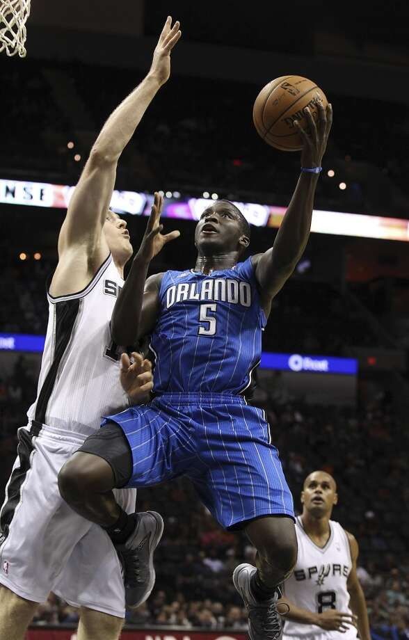 Orlando Magic's Victor Oladipo goes up for a shot against the Spurs' Aron Baynes during their preseason game at the AT&T Center on Tuesday, Oct. 22, 2013. Spurs prevailed 123-101. Photo: Kin Man Hui, San Antonio Express-News