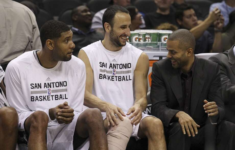 Spurs' Tim Duncan (from left), Manu Ginobili and Tony Parker share a laugh on the bench during the preseason game against the Orlando Magic at the AT&T Center on Tuesday, Oct. 22, 2013. Spurs prevailed 123-101. Photo: Kin Man Hui, San Antonio Express-News