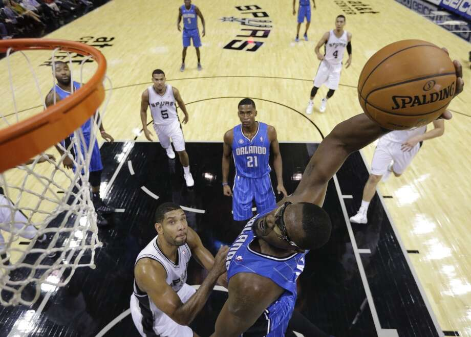 Orlando Magic's Jason Maxiell, right, dunks the ball over San Antonio Spurs' Tim Duncan, left, during the first half of a preseason NBA basketball game, Tuesday, Oct. 22, 2013, in San Antonio. Photo: Eric Gay, Associated Press