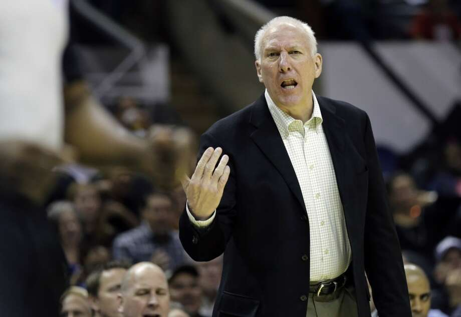 San Antonio Spurs head coach Gregg Popovich talks to an official during the first half of a preseason NBA basketball game against the Orlando Magic, Tuesday, Oct. 22, 2013, in San Antonio. Photo: Eric Gay, Associated Press