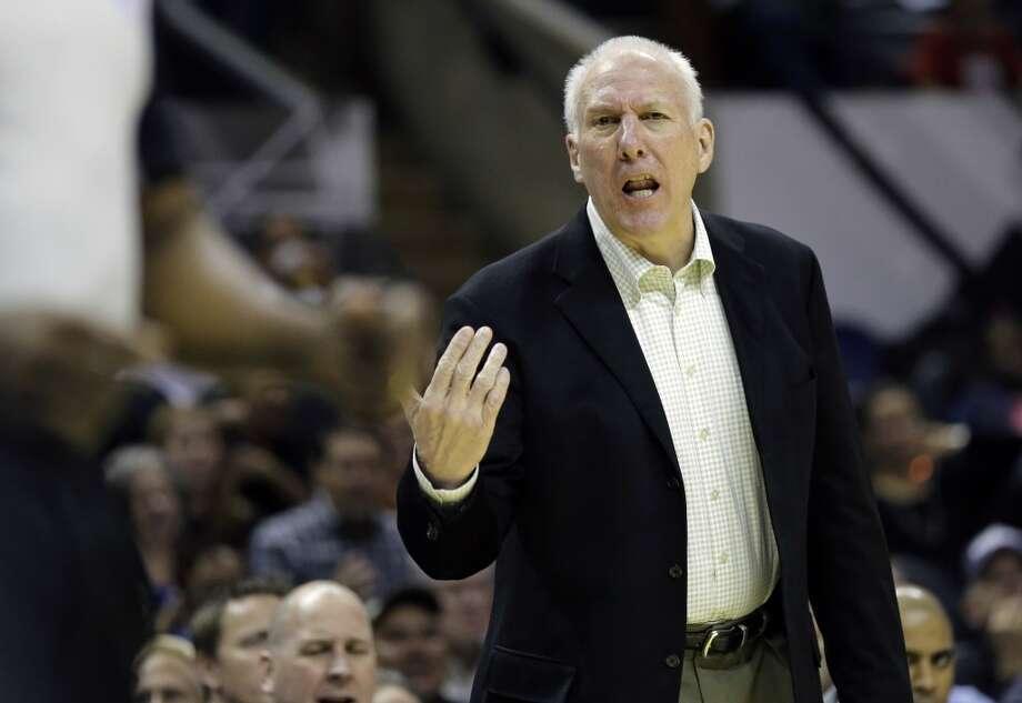 San Antonio Spurs head coach Gregg Popovich talks to an official during the first half of a preseason NBA basketball game against the Orlando Magic, Tuesday, Oct. 22, 2013, in San Antonio. Photo: Eric Gay, Associated Press