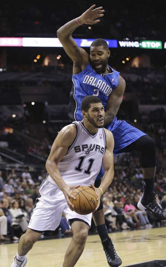 San Antonio Spurs' Jeff Ayres (11) drives to the basket as Orlando Magic's Kyle O'Quinn (2) defends during the second half of a preseason NBA basketball game, Tuesday, Oct. 22, 2013, in San Antonio. San Antonio won 123-101. Photo: Eric Gay, Associated Press