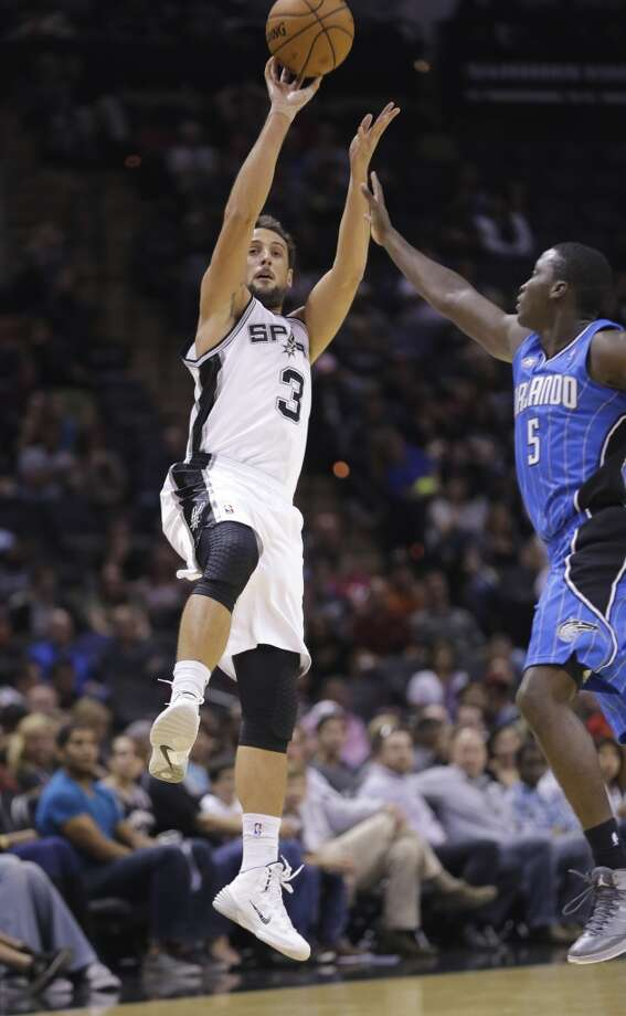 San Antonio Spurs' Marco Belinelli (3), of Italy, shoots over Orlando Magic's Victor Oladipo (5) during the second half of a preseason NBA basketball game, Tuesday, Oct. 22, 2013, in San Antonio. San Antonio won 123-101. Photo: Eric Gay, Associated Press