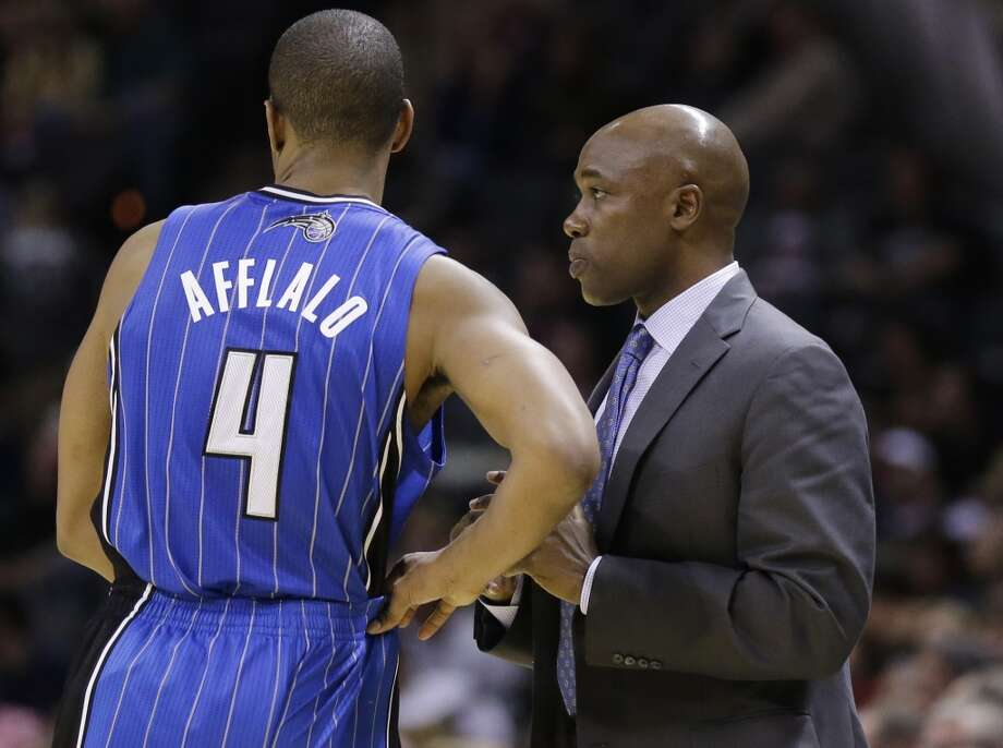 Orlando Magic head coach Jacque Vaughn, right, talks with Arron Afflalo (4) during the second half of a preseason NBA basketball game against the San Antonio Spurs, Tuesday, Oct. 22, 2013, in San Antonio. San Antonio won 123-101. Photo: Eric Gay, Associated Press