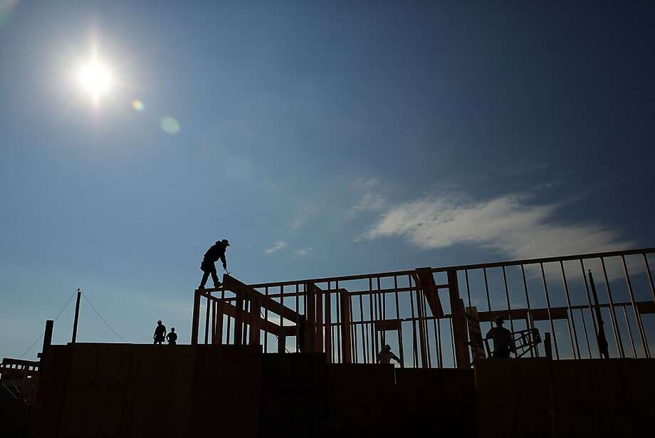 NEW YORK, NY - OCTOBER 22:  Builders construct new homes in an area that was heavily damaged by fire in Hurricane Sandy on October 22, 2012 in the Breezy Point neighborhood of the Queens borough of New York City. As the one-year anniversary of Hurricane Sandy approaches, many residents of the Rockaways and neighboring Breezy Point are reflecting on the progress made over the past year while acknowledging the problems still evident. While the area has made great headway with rebuilding and renovations to the iconic beach communities, the storm devastated much of the area with severe flooding and wind damage. Hurricane Sandy made landfall on October 29 near Brigantine, New Jersey and affected 24 states from Florida to Maine and cost the country an estimated $65 billion.  (Photo by Spencer Platt/Getty Images) Photo: Spencer Platt, Getty Images